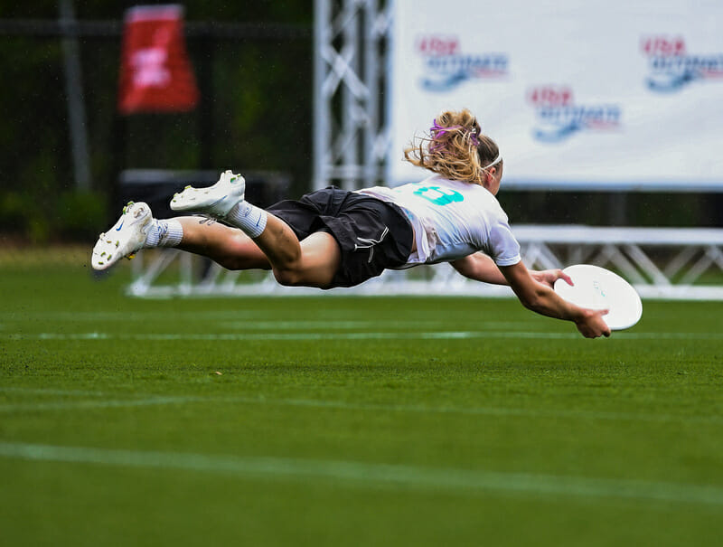 Claire Revere makes an diving grab in the endzone for Whitman. Photo: Brian Canniff -- UltiPhotos.com