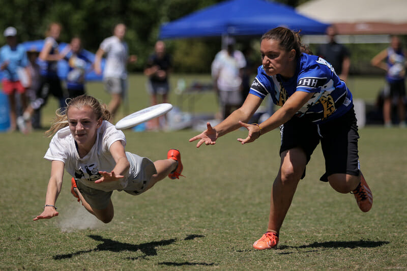 HB Woodlawn's Ella Juengst lays out for the D against Paideia. Photo: Christina Schmidt -- UltiPhotos.com