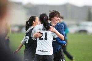 Whitman's Alex Hardesty and UBC's Ellen Au-Yeung embrace. Photo: Brian Chu -- UltiPhotos.com