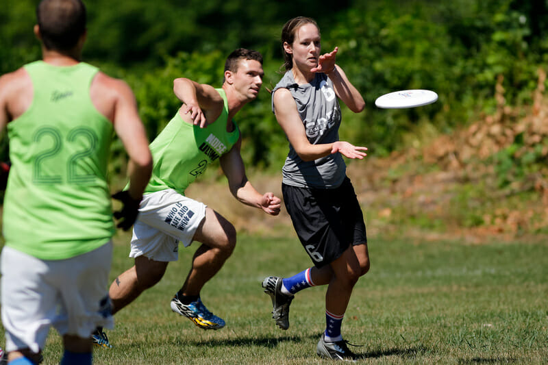 A shaped throw to the correct side of your receiver can seal off a defender and prevent them from making bid. Photo: Burt Granofsky -- UltiPhotos.com
