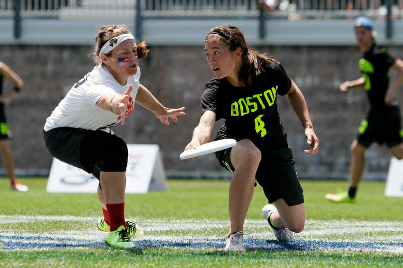Brute Squad's Liên Hoffmann throws a big fake against Seattle Riot in the 2016 US Open Final. Photo: Burt Granofsky  --  UltiPhotos.com