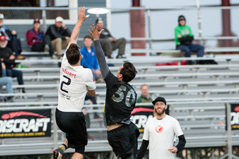 Nick Stuart (Sockeye #2) gets up over Beau Kittredge (Revolver #50) in the final round of Men's Pool Play at the USA Ultimate Club National Championships. Photo: Jeff Bell -- UltiPhotos.com