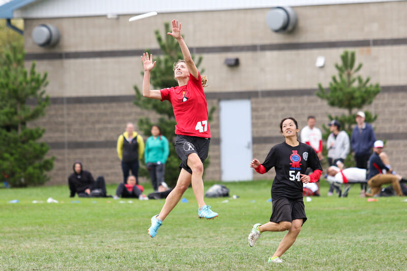Mischief's Gina Schumacher skies for the disc in their semifinal against Metro North. Photo: Paul Rutherford -- UltiPhotos.com