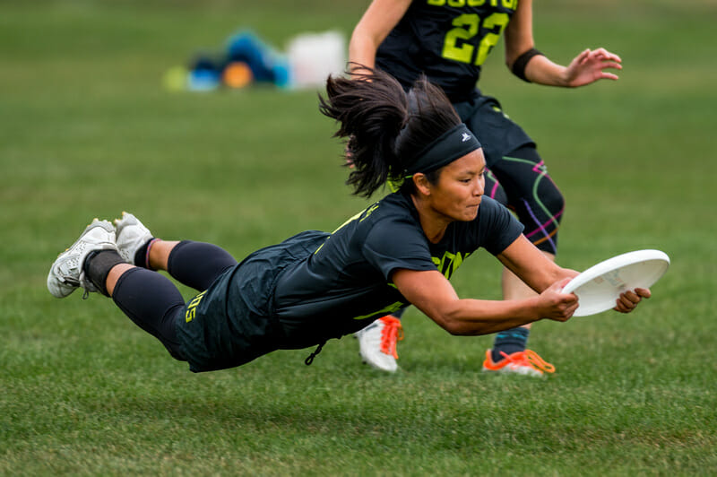 Cassie Wong of Brute Squad secures the catch with a layout in the quarterfinals of the 2016 Club Championships.
