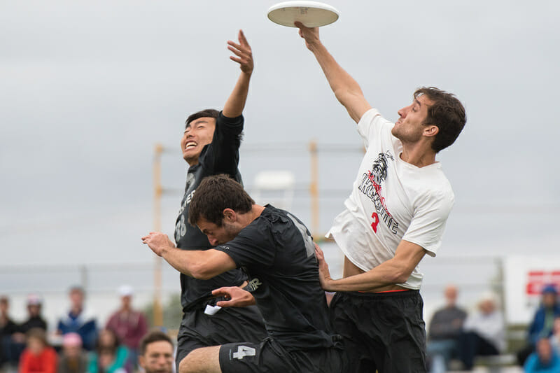 Ironside's Kurt Gibson skies for the grab over two Revolver defenders. Photo: Jeff Bell -- UltiPhotos.com