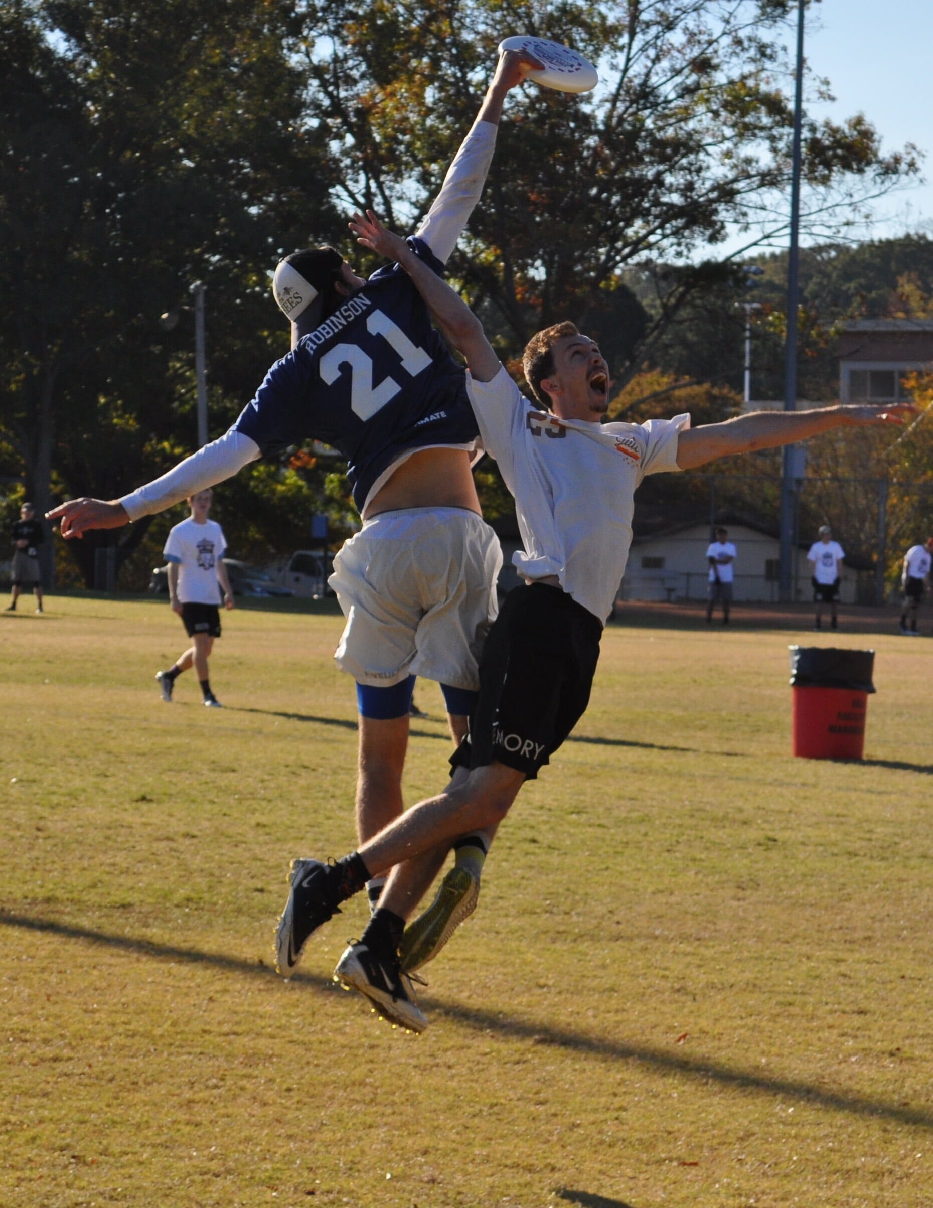 - Noah Robinson skies an Emory defender on Saturday.