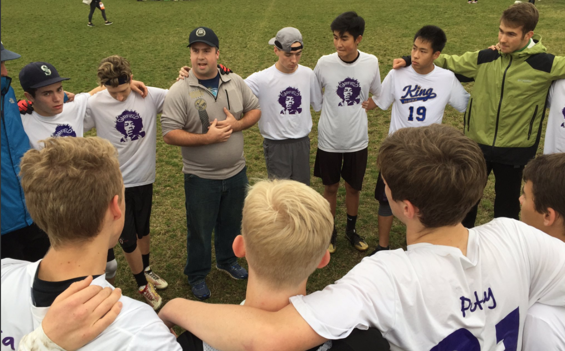 Garfield's Purple Haze receives some pointers from coach Rusty Brown. Photo courtesy of UltiWorld.