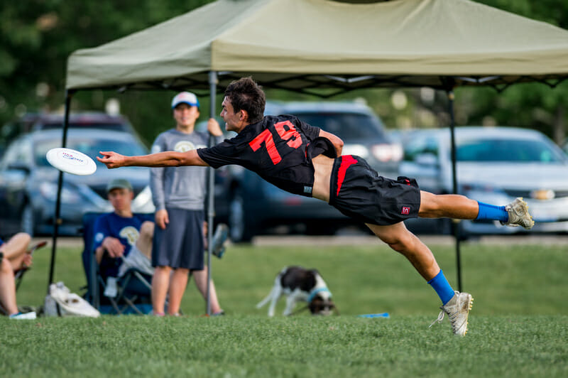 Pittsburgh's Mike Ing bids for a disc at the 2017 College Championships.