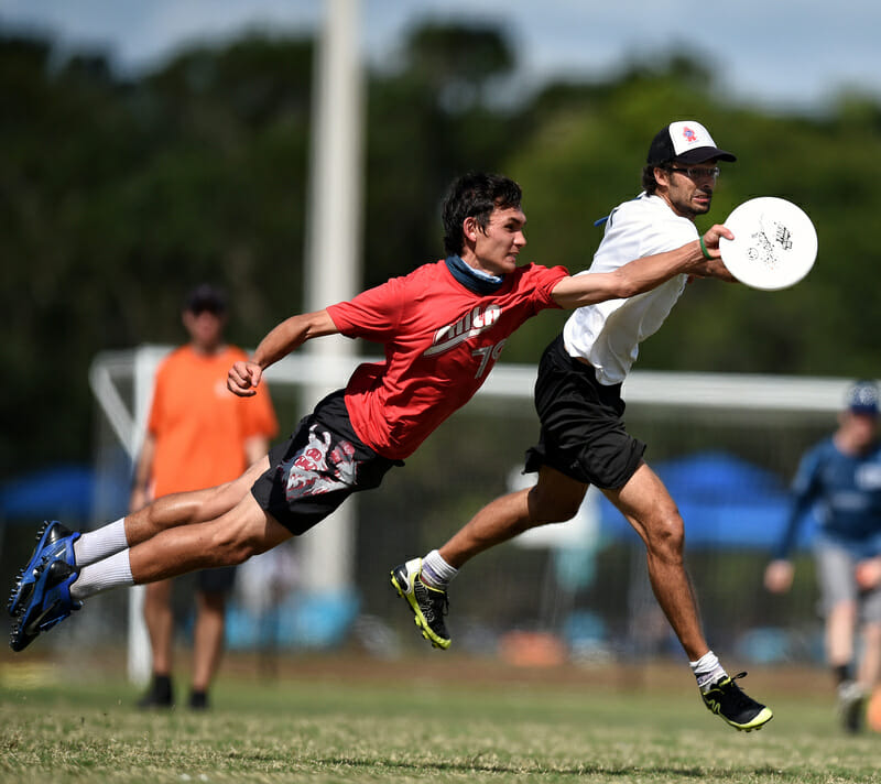 AMP's Michael Ing extends to make the play at 2017 Club Nationals.