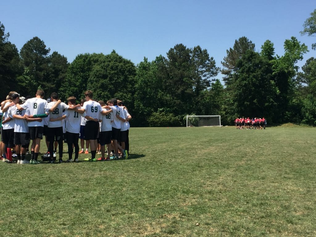 Carolina Friends and Center Grove huddle up during a timeout in the final moments of the final of Paideia Cup 2018.