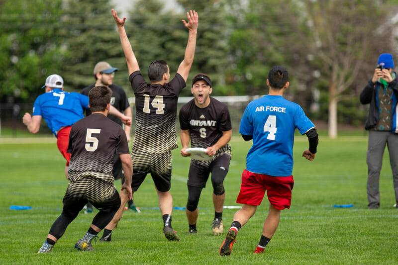 Bryant's Zach Tuxbury and his teammates celebrating the game winning goal of the 2018 D-III College Championship final.
