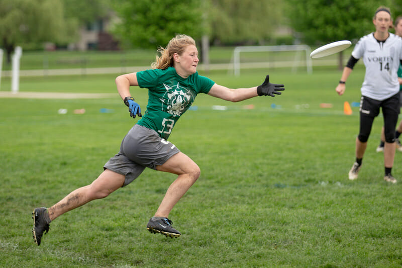 Puget Sound's Emma Piorier attacks the disc at the 2018 D-III College Championships.
