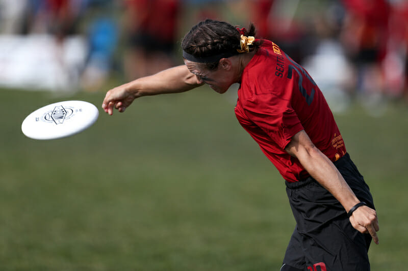 Riot's Charlie Edie releases a powerful backhand in the quarterfinal round of WUCC 2018.