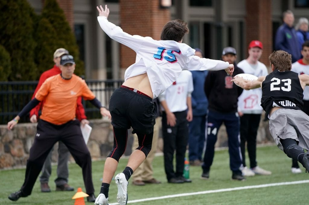 UNC's Walker Matthews gets a layout block in the final of Carolina Kickoff 2019.