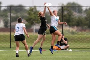 Colorado's Rachel Wilmoth goes up against a UCLA player in the air at the 2019 D-I College Championships.