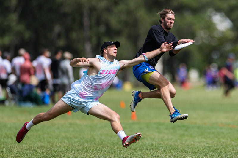 Tannor Johnson of Slow White and Peter Prial of Snake Country — two stars of the mixed division — faced off at the 2019 Boston Invite. Photo: Alec Zabrecky -- UltiPhotos.com