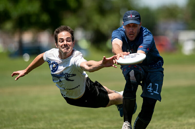 Burlington No Country goes for the block against Chicago Archive in the Grand Masters Men's division of the 2019 USAU Masters Championships. Photo: Sam Hotaling -- UltiPhotos.com