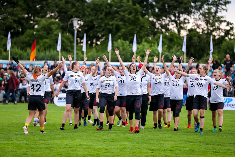 The German women's team take the field for the opening showcase game of the WFDF 2019 U24 World Championships. Photo: Paul Rutherford -- UltiPhotos.com