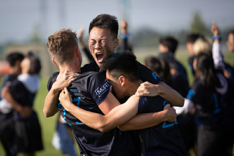 Players on Vancouver Eclipse celebrate their Junior Division victory at the 2019 Canadian Ultimate Championships. Photo: Jon Hayduk -- UltiPhotos.com