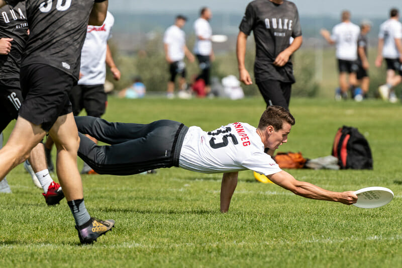 Alan Scarth of Winnipeg General Strike goes to ground at the 2019 Canadian Ultimate Championships. Photo: Jeff Bell -- UltiPhotos.com