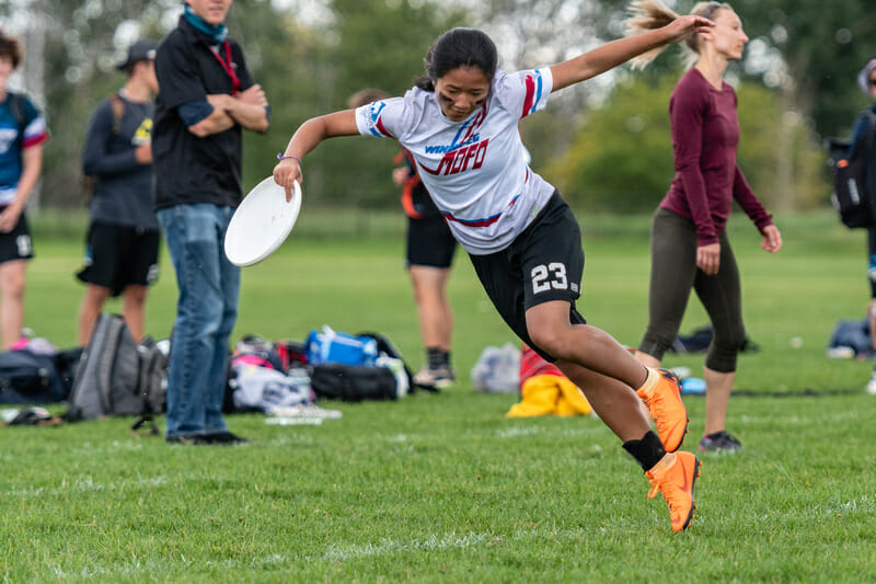 Tien Le of Winnipeg MOFO toes the sideline during the Junior Division of the 2019 Canadian Ultimate Championships. Photo: Jeff Bell -- UltiPhotos.com