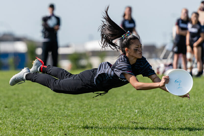 Tracey Dao of Toronto with a sweet layout during semifinal action in the Junior Division of the 2019 Canadian Ultimate Championships. Photo: Jeff Bell -- UltiPhotos.com