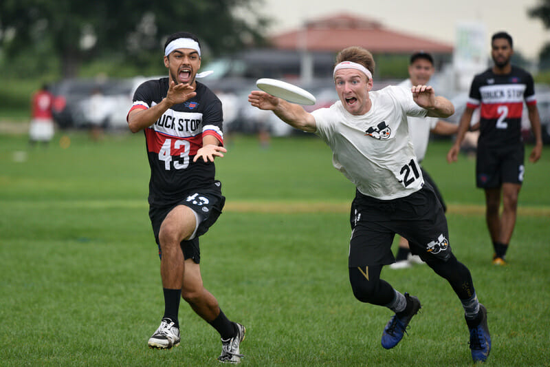 Truck Stop's Nathan Prior and Sub Zero's Codi Wood both have eyes for the disc at the 2019 US Open. Photo: Jolie J Lang -- UltiPhotos.com