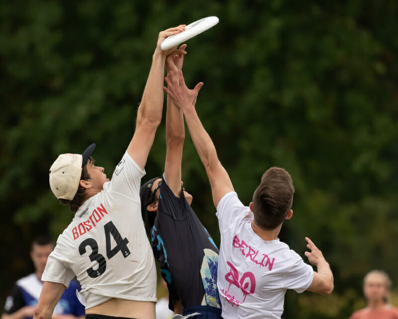 Three players challenge in the air for the disc at Force Freedom 2019. Photo: Kevin Wayner -- UltiPhotos.com