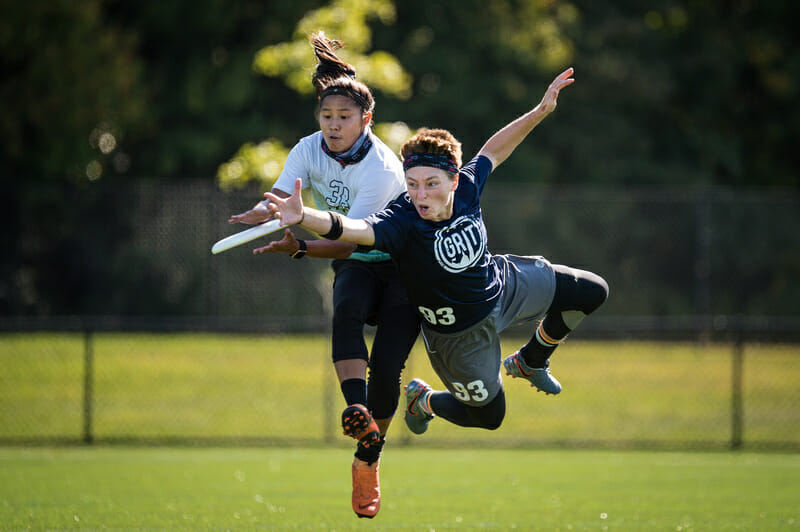 The focus from both players here is intense during the matchup between New Jersey Pine Baroness and Washington DC Grit at 2019 Mid-Atlantic Club Regionals. Photo: Paul Andris -- UltiPhotos.com