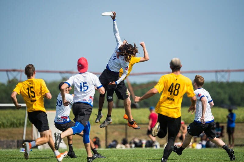 Washington DC Truck Stop's Delrico Johnson skies for the grab at 2019 Mid-Atlantic Club Regionals. Photo: Paul Andris -- UltiPhotos.com