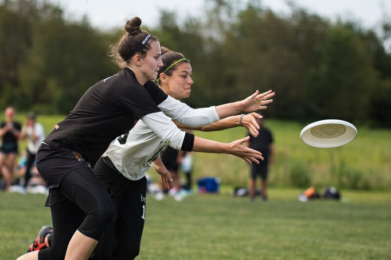 Seattle Riot's Qxhna Titcomb and Boston Brute Squad's Erin Rea vie for the disc at the 2019 Pro Championshps. Photo: Paul Andris -- UltiPhotos.com