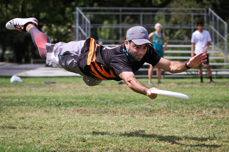 San Francisco Firefly's Simon Margolis makes the layout grab at 2019 Nor Cal Mixed Sectionals. Photo: Kristina Geddert -- UltiPhotos.com