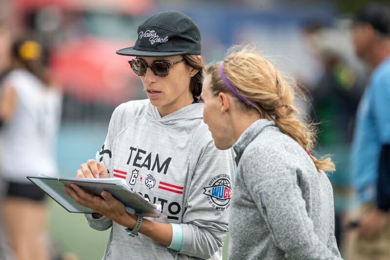 Toronto 6ixers coaches Carla DiFilippo and Alena Papayanis consult on the sideline during the 2019 Club Championships final. Photo: Rodney Chen -- UltiPhotos.com
