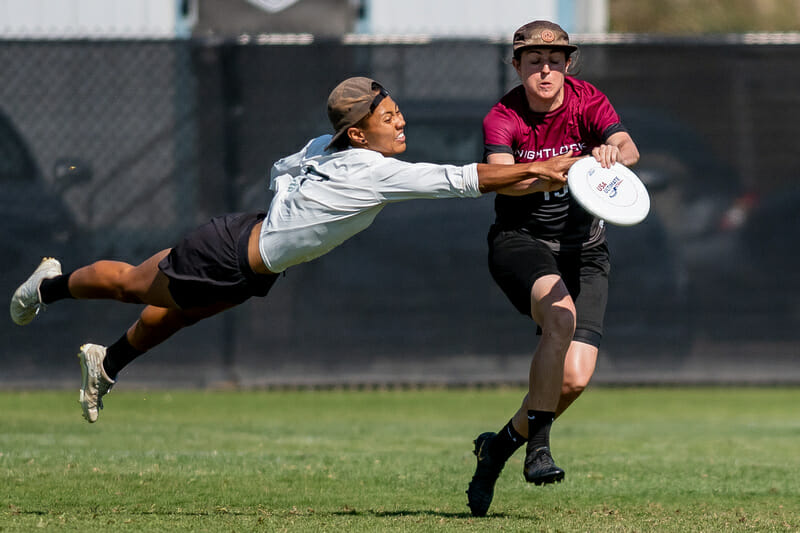 Opi Payne gets a block at the 2019 Club Championships. Photo: Sam Hotaling -- UltiPhotos.com