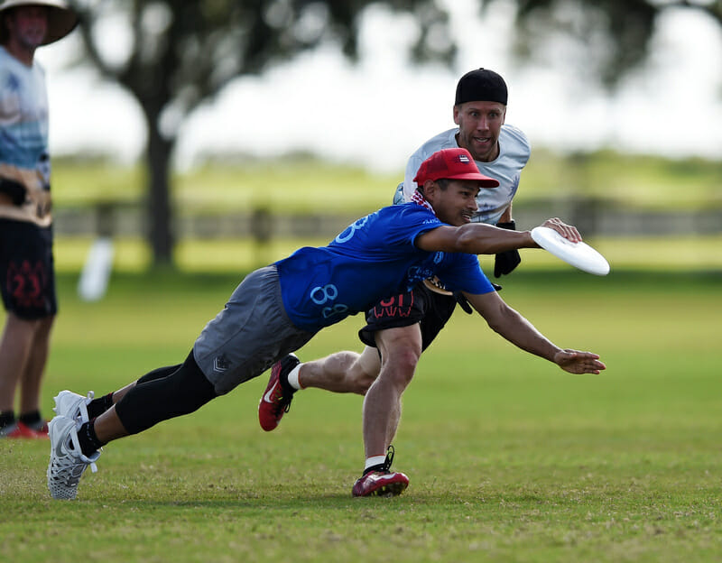 Unambiguously Grey's Calvin Oung makes a great grab at PAUC 2019. Photo: Billy Dzwonkowski -- UltiPhotos.com
