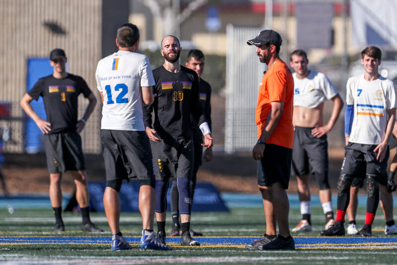 Revolver's Grant Lindsley, PoNY's Matt Lemar, and observer Jonathan Monforti discuss a controversial dangerous play call in the 2018 Club Championships Men's final. Photo: Paul Rutherford -- UltiPhotos.com