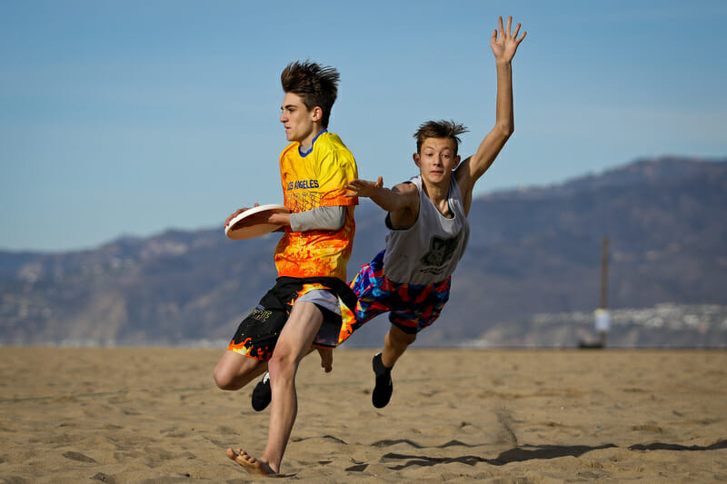 A close bid against a beautiful backdrop during U20 pool play at the Beach of Dreams event in Los Angeles. Photo: Kristina Geddert -- UltiPhotos.com