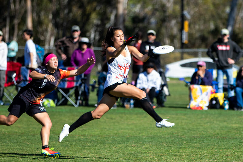Stanford captain Maika Isogawa makes a catch in front of UCSB at the 2020 Presidents' Day Invite. Photo: Greg Pettus -- UltiPhotos.com