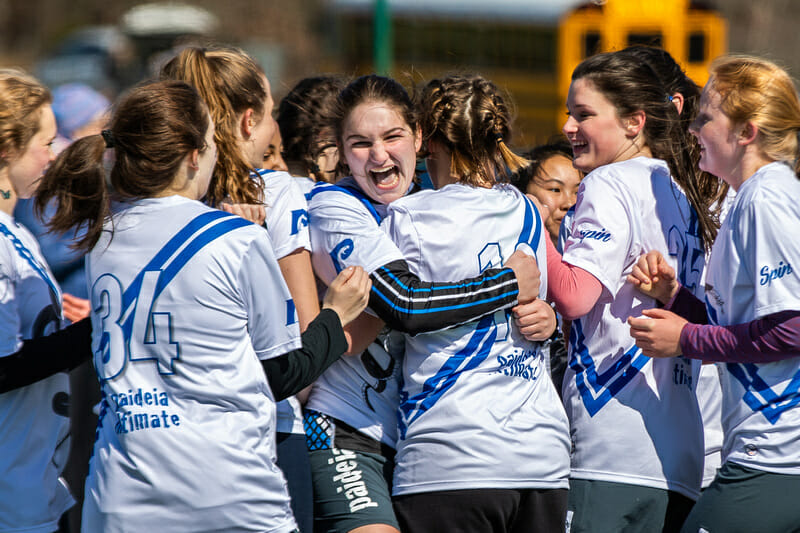The Paideia Girls in an exuberant embrace at QCTU HS. Photo: Katie Cooper -- UltiPhotos.com