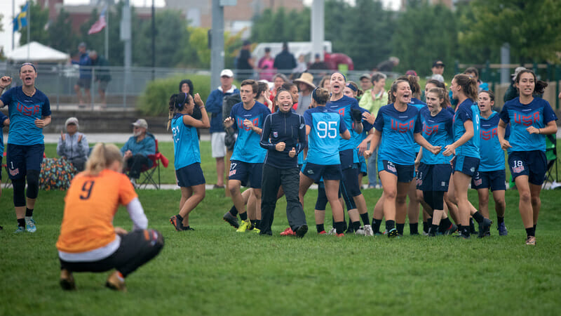 The US girls celebrate a double game point win over Netherlands at wjUC 2018. Photo: Jolie J Lang -- UltiPhotos.com