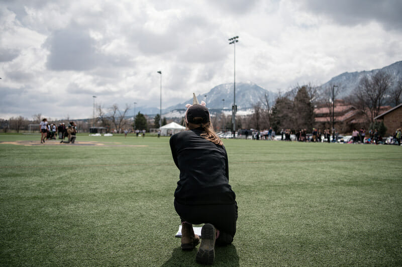 Colorado coach Claire Chastain surveys the field at the Rocky Mountain D-I Conference Championships in 2019. Photo credit: Sam Hotaling -- UltiPhotos.com