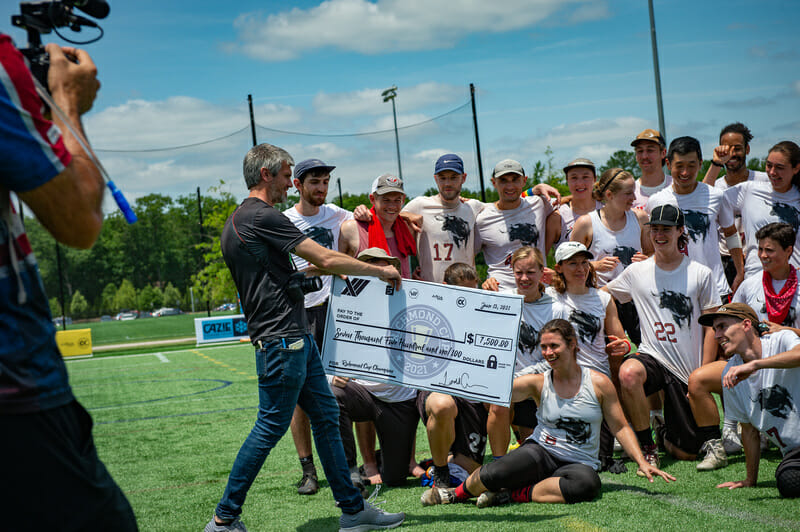 Todd Curran of XII Brands presents the first-place prize check to inaugural Richmond Cup champs Durham Toro. Photo credit: Kevin Leclaire — UltiPhotos.com