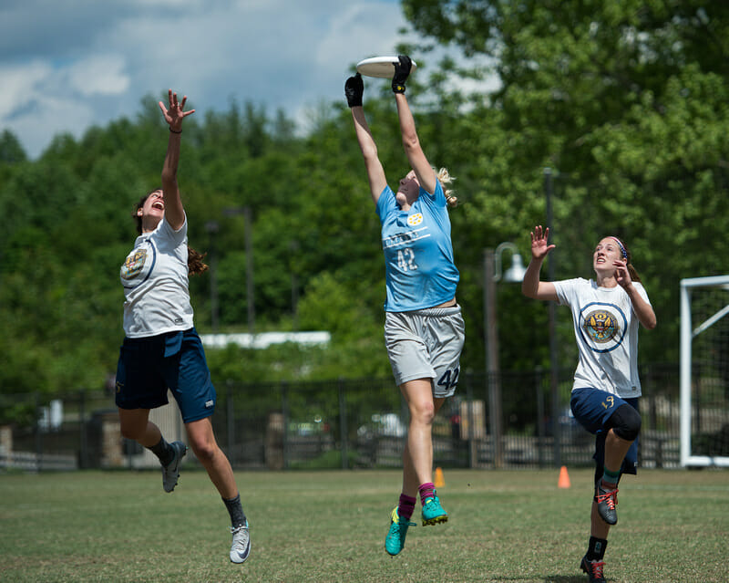 North Carolina's Rebecca Fagan makes a catch over two defenders at Atlantic Coast Regionals 2017.