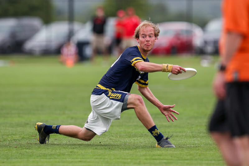 Michigan's Adam Stautberg steps out for a backhand at the 2019 USA Ultimate D-I College Championships.