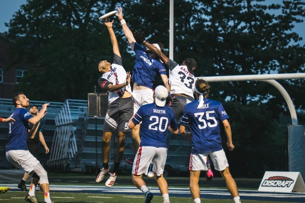 The Chicago Union and Detroit Mechanix go up for a contested jump ball in the 2021 American Ultimate Disc League.