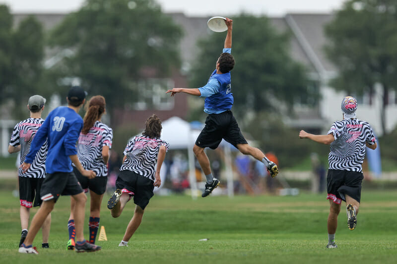 Sayric Arias of Oregon Rapids gets up to make the catch at the Youth Club Championships. Photo: Paul Rutherford -- UltiPhotos.com