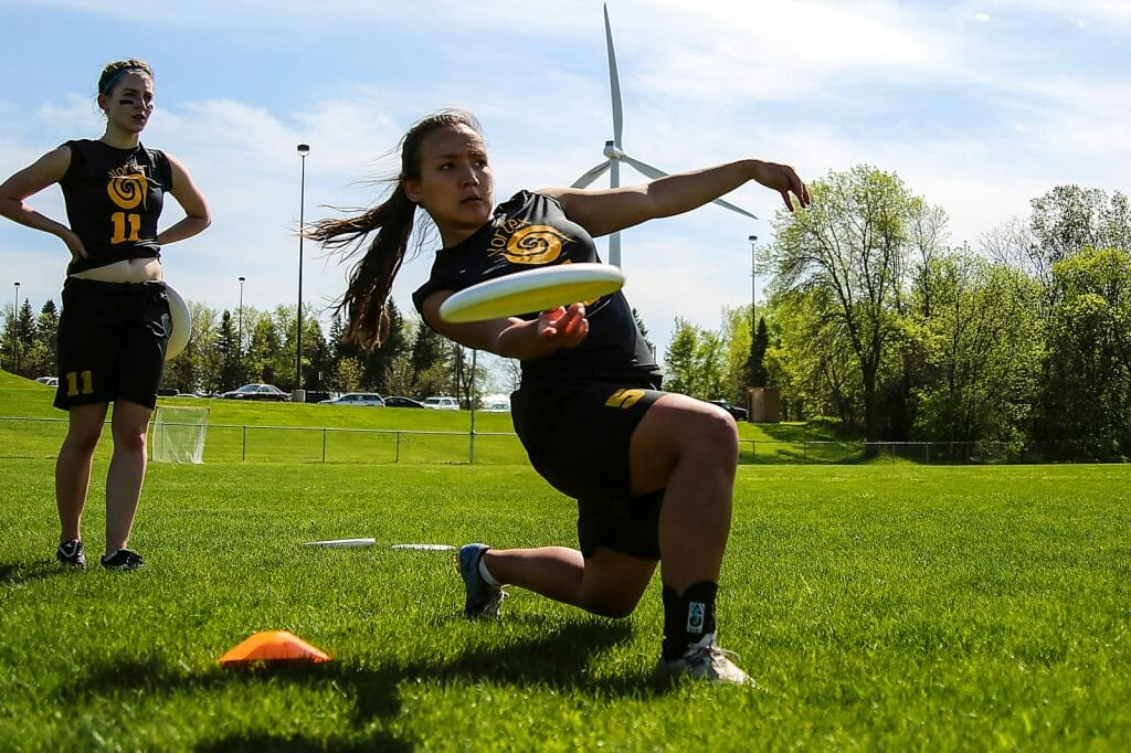 Players for St. Olaf Vortex, the college's women's ultimate frisbee team, prepare for a game. Photo: Alex Fraser -- UltiPhotos.com