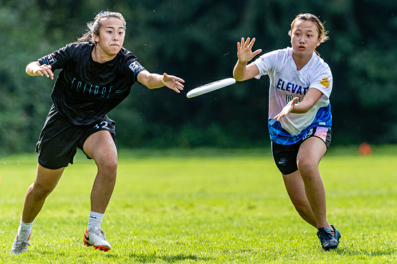 Two players vie for the disc at the British Columbia Junior Ultimate Championships. Photo: Jeff Bell -- UltiPhotos.com