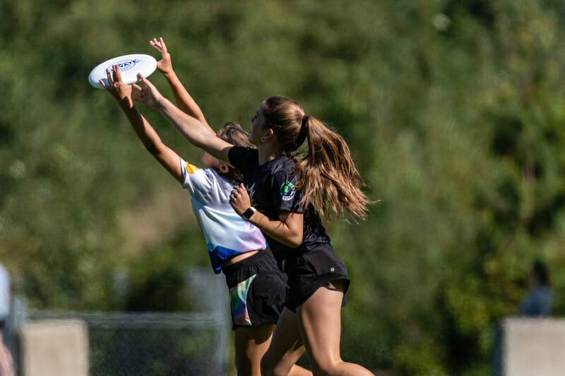 Players attack the disc at the British Columbia Junior Ultimate Championships. Photo: Jeff Bell -- UltiPhotos.com