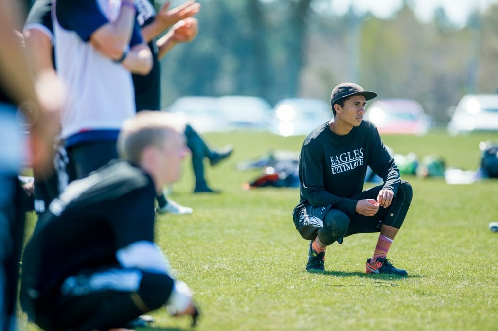 North Texas men's college ultimate frisbee players gaze towards the field. Photo: Taylor Nguyen -- UltiPhotos.com